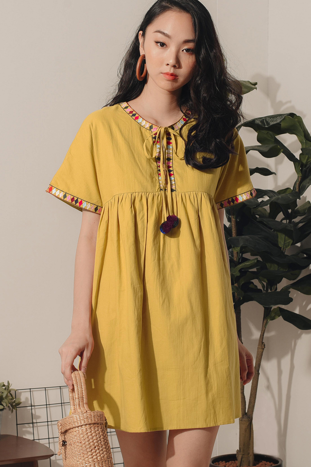 EMBROIDERY POM POM DRESS IN MUSTARD