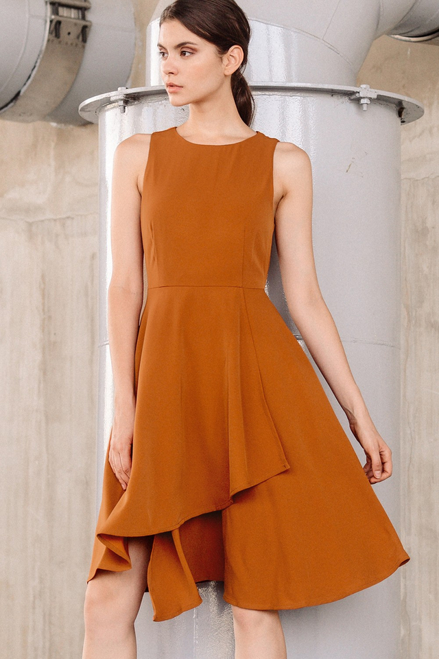 NOLAN ASYMMETRICAL DRESS IN RUST BROWN